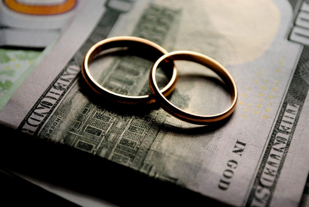 wedding rings and $100 bills