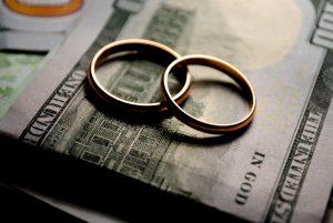 wedding rings and $100 bills